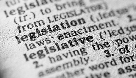 Close up photograph of the page of a dictionary focused on the word legislation
